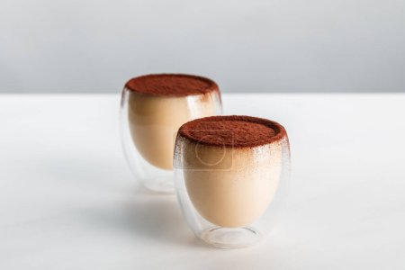 Photo for Sweet mousse with cocoa powder in two glasses - Royalty Free Image