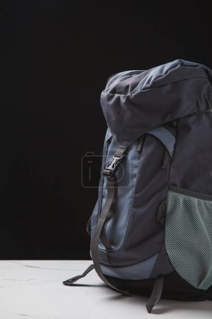 Photo for Close-up view of backpack for hiking on black background, travel concept - Royalty Free Image