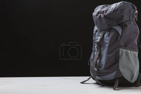 Photo for Backpack for trekking on black background, travel concept - Royalty Free Image
