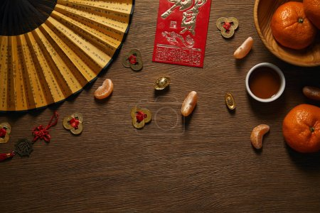 top view of chinese new year composition on wooden surface