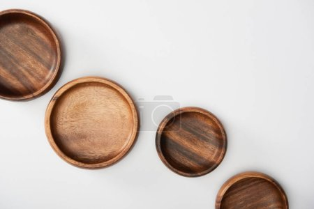 Photo for Top view of wooden bowls on white background - Royalty Free Image