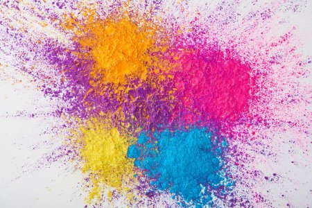 Photo for Top view of explosion of multicolored holi powder on white background - Royalty Free Image