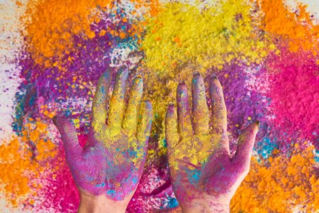 cropped view of woman with hands in multicolored holi powder