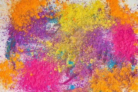 top view of explosion of multicolored holi powder