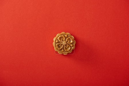 top view of traditional chinese mooncake isolated on red