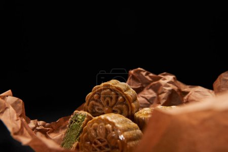 Photo for Selective focus of traditional chinese mooncakes isolated on black with copy space - Royalty Free Image