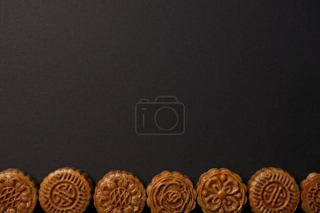 Photo for Top view of traditional chinese mooncakes isolated on black with copy space - Royalty Free Image
