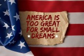 vintage crumpled paper with america is too great for small dreams quote on american flag