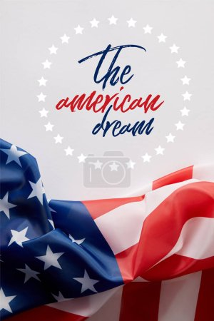 Photo pour Top view of united states of america flag and the american dream lettering on white surface - image libre de droit