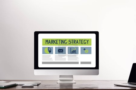 Photo for Computer with marketing strategy illustration on screen at workplace on grey background - Royalty Free Image