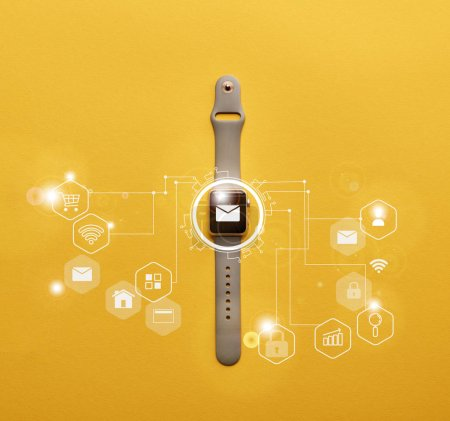 Photo for Top view of smartwatch with system notification on yellow surface - Royalty Free Image
