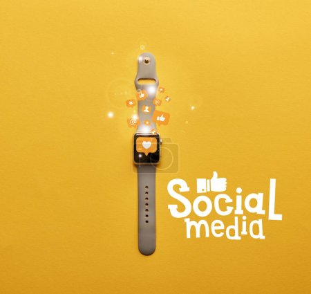 top view of smartwatch with icons and social media lettering on yellow surface