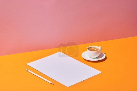 Photo for Paper sheet, pencil and coffee cup on yellow desk and pink background - Royalty Free Image