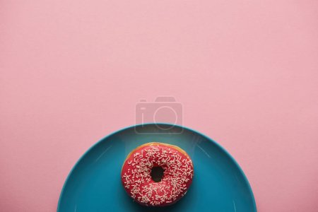 Photo for Top view of tasty donut on blue plate isolated on pink - Royalty Free Image