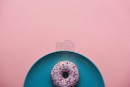 Photo for Top view of sweet donut on blue plate isolated on pink - Royalty Free Image