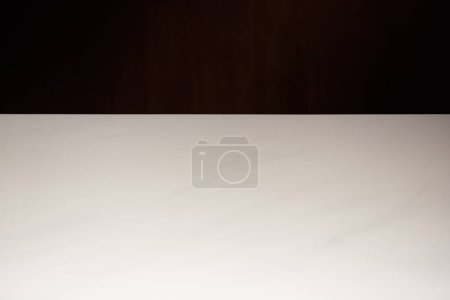 Photo for Empty white textured table isolated on black - Royalty Free Image