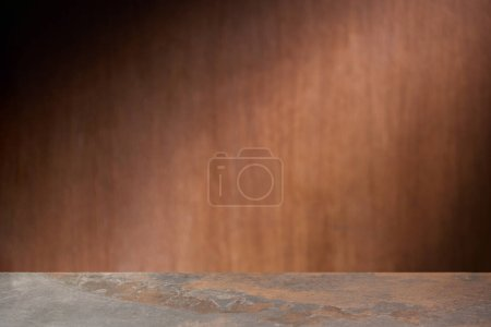 selective focus of textured table with wooden wall on background