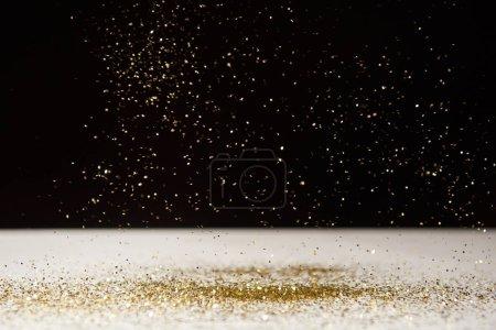 Photo pour White table with bright sparkles isolated on black - image libre de droit