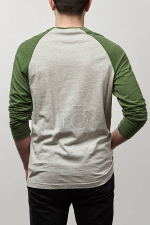 Photo for Back view of man in raglan sleeve baseball shirt with copy space isolated on grey - Royalty Free Image