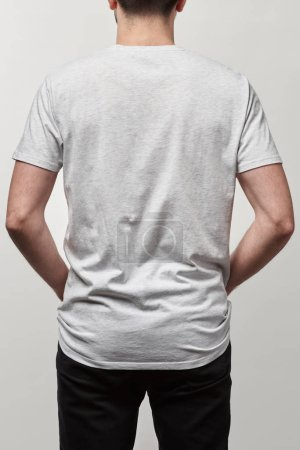 back view of man in casual white t-shirt with copy space isolated on grey