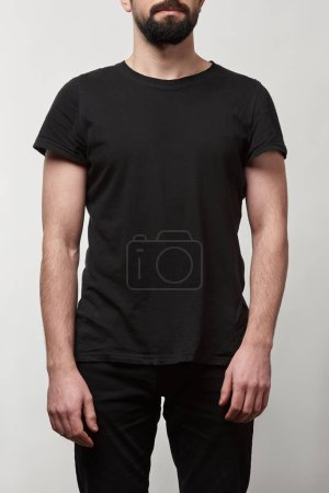 Photo for Partial view of bearded man in black t-shirt with copy space isolated on grey - Royalty Free Image