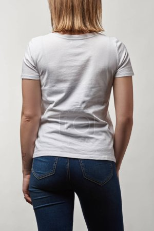 back view of young woman in white cotton t-shirt with copy space isolated on white