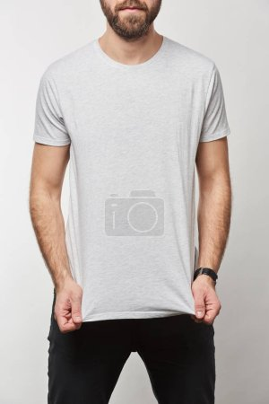 partial view of bearded man in white t-shirt with copy space isolated on grey
