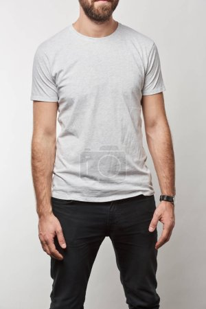 partial view of man in white t-shirt with copy space isolated on grey