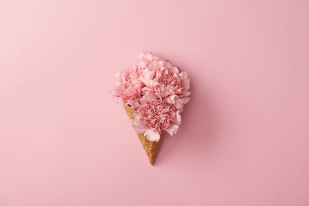 Photo for Beautiful pink carnation flowers in waffle cone isolated on pink - Royalty Free Image