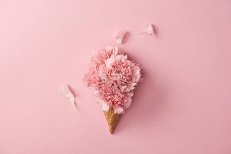 Photo for Beautiful pink carnation flowers in wafer cone isolated on pink - Royalty Free Image