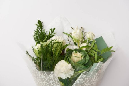 Photo for Beautiful tender white flowers with green leaves isolated on grey - Royalty Free Image