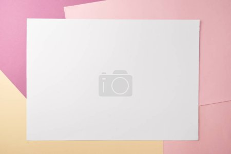 Photo for Top view of blank white card and empty colored paper background - Royalty Free Image