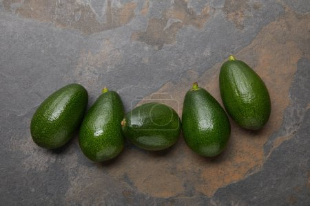 Photo for Top view of avocados on grey background - Royalty Free Image