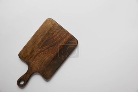 Photo for Top view of wooden cutting board on grey background - Royalty Free Image