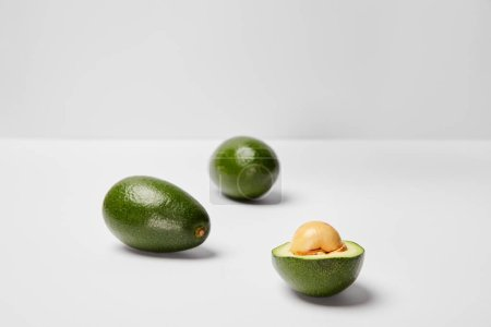 Photo for Selective focus of avocados on grey background - Royalty Free Image