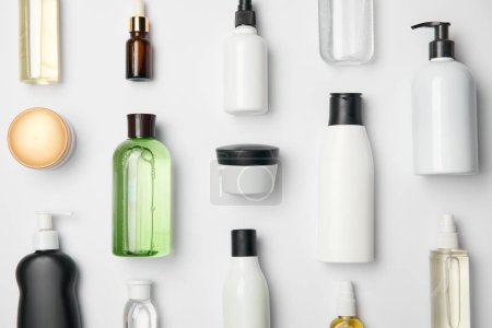 Photo for Top view of different cosmetic bottles and container on white background - Royalty Free Image