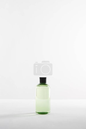 Photo for Transparent vosmetic bottle with lotion on white background with copy space - Royalty Free Image