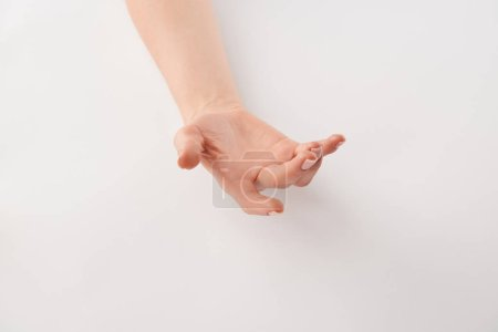 Photo for Partial view of female well-cared open hand on white background - Royalty Free Image