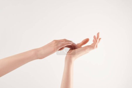 Photo for Partial view of well-cared female hands on white background - Royalty Free Image