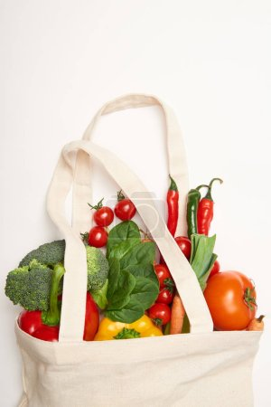 Photo for Studio shot of eco bag with vegetables on white background - Royalty Free Image