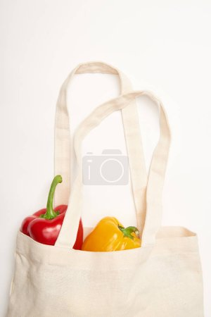 Photo for Studio shot of bell peppers in eco bag on white background - Royalty Free Image