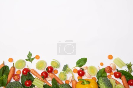 Photo for Top view of spinach leaves and vegetables on white background - Royalty Free Image