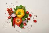 """Постер, картина, фотообои """"Вид сверху свежих овощей и специй на сером фоне"""""""