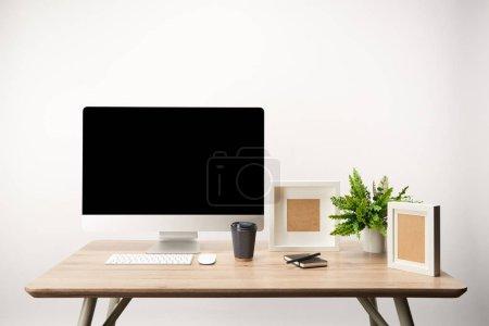 Foto de Lugar de trabajo con café para llevar, Marcos, planta y computadora de escritorio con copia espacio, aislada sobre fondo blanco - Imagen libre de derechos