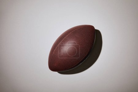 top view of brown football on white background