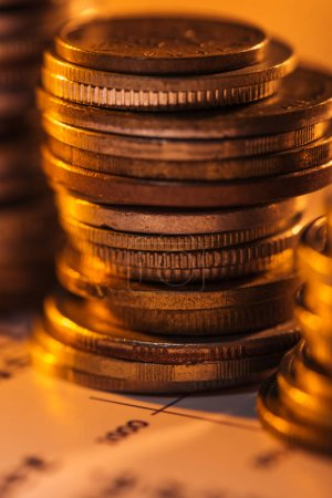 Photo for Selective focus of coins stack on blurred document and background - Royalty Free Image