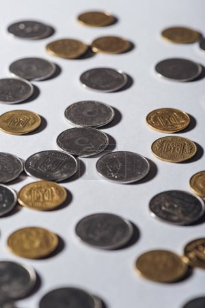 Photo for Selective focus of ukrainian coins on grey blurred background - Royalty Free Image