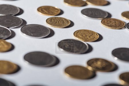 Photo for Selective focus of laid out ukrainian coins on grey background - Royalty Free Image
