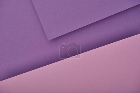 top view of purple laid out paper sheets with copy space