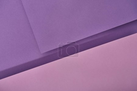 top view of violet and purple paper sheets with copy space